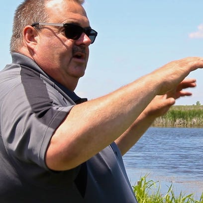 Two Rivers native and landowner Paul Becker shows off