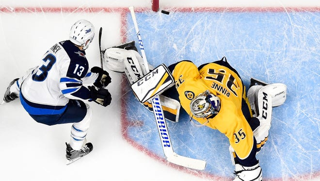 Winnipeg Jets left wing Brandon Tanev (13) scores a goal past Nashville Predators goaltender Pekka Rinne (35) during the first period of game 1 in the second round NHL playoffs at Bridgestone Arena, Friday, April 27, 2018, in Nashville, Tenn.
