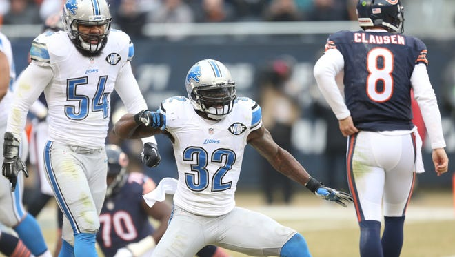 Lions James Ihedigbo celebrates the tackle on Bears Matt Forte during first half action today Soldier Field in Chicago.