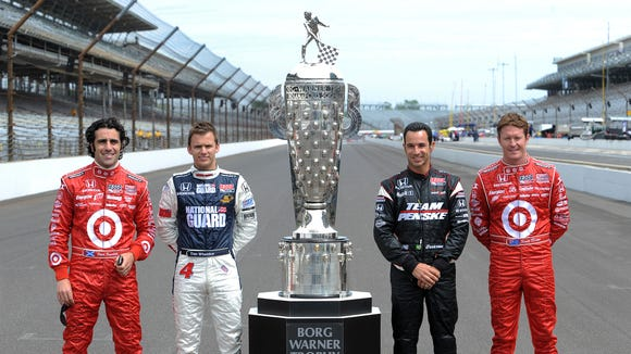 Who's No. 1 in this group among Indianapolis 500 money leaders: It's Helio Castroneves (in black) followed by Dario Franchitti (far left) and Dan Wheldon (white pants)
