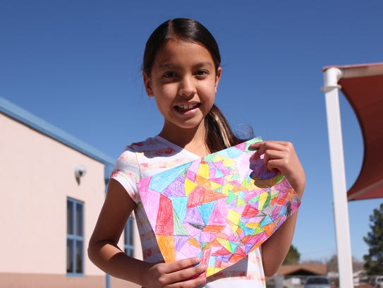 Ashley Apodaca, 11, shows her work for the Luna County