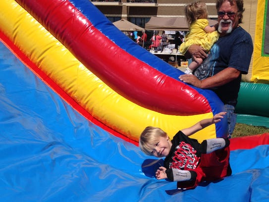 Connor Mayes, 4, plays on the inflatables at Mount