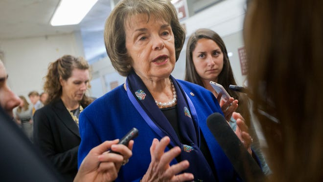 In this June 2 photo, Sen. Dianne Feinstein, D-Calif., speaks with reporters on Capitol Hill in Washington. People on the U.S. government's terrorist watch list can't board commercial airliners, but they can walk into a gun store and legally buy pistols and powerful military-style rifles. The new Democratic push, which is considered unlikely to succeed in the GOP-controlled Congress, is focused on legislation by Feinstein that would let the attorney general compile a list of known and suspected terrorists.