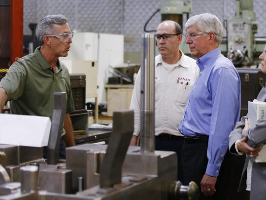 Governor Rick Snyder, on the right, at Denso Manufacturing in Battle Creek.