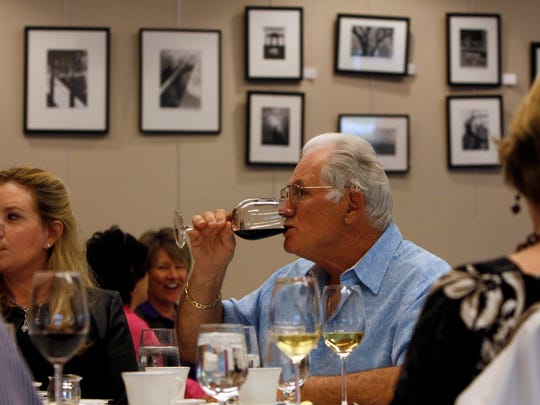 Mary Clare Lyons, left, and Dave Copham drink a chardonnay and a merlot, respectively, at the Southwest Florida Wine & Food Fest Dinner Host Appreciation Luncheon Friday in Fort Myers.