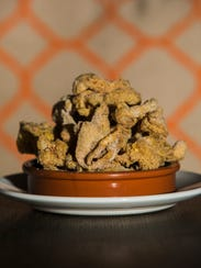 The crispy chicken skins are made with fried chicken