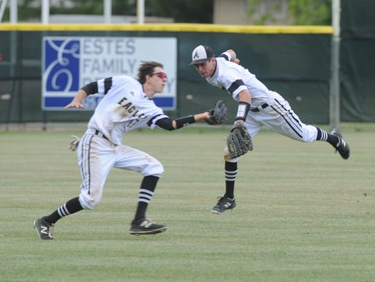 Abilene High left fielder Josh Carroll, left, makes the catch on Zackary Gregory's fly ball for the second out in the seventh while center fielder Doak Holloway tries to get out of the way. AHS won the game against Timber Creek 4-1 at Blackburn Field.