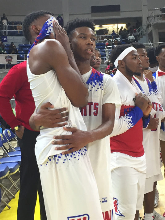 636562276239267795-Jalen-Brooks-consoled-by-Moton.png