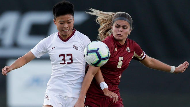 Florida State midfielder Yujie Zhao (33) battles for the ball against Boston College at the Seminole Soccer Complex Thursday, Sept. 19, 2019.