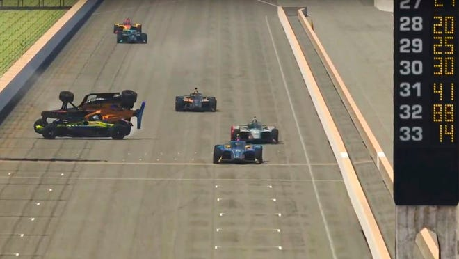 In this image taken from video provided by iRacing IndyCar, drivers Oliver Askew (orange) and Santino Ferrucci, left, collide on the final stretch allowing Scott McLaughlin, right, to win the First Responder 175 presented by GMR virtual IndyCar auto race at the Indianapolis Motor Speedway, Saturday, May 2, 2020, in Indianapolis, Ind.