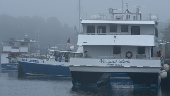 Boat crews ready to set out from the Ocean Street Docks on a foggy morning which burned off into a muggy afternoon.