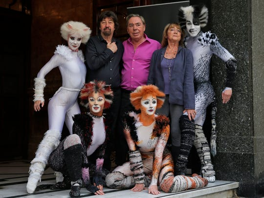 British composer Andrew Lloyd Webber, center, director