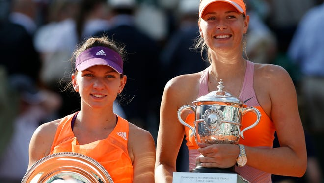 Top seeded Simona Halep, left, was drawn with Maria Sharapova  in the tougher group for the season-ending WTA finals.