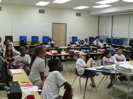 Students listen to lessons provided by certified science