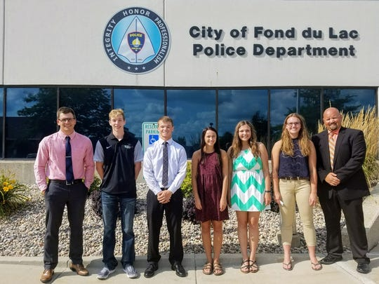 The Fond du Lac Professional Police Benevolent Association, or FDL PPBA, has awarded scholarships to five local students. Pictured are, from left: FDL PPBA President Officer Dylan Thurmer, Dylon Pokorny, Jacob Borgwardt, Caray Franke, Kailee Simon, Zoe Albert and FDL PPBA Member Detective Nick Hahn.
