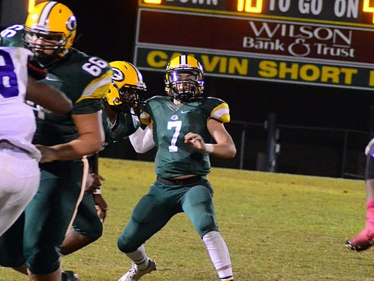 Gallatin's Collin Minor looks to pass during a 2016