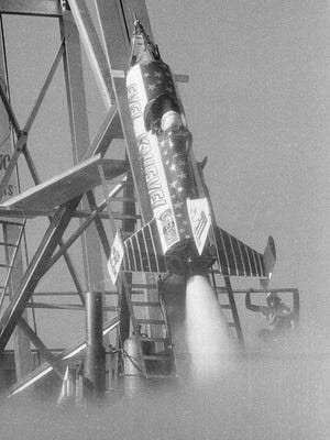 In this Sept. 6, 1974, file photo, American daredevil Evel Knievel sits in the cockpit as steam pours from his Skycycle during a final static test of the systems that will try to propel him across the Snake River Canyon, near Twin Falls, Idaho. Fueled by the memory of the late daredevil Knievel, Hollywood stuntman Eddie Braun plans to strap into a steam-powered rocket cycle on Sept. 17, 2016, for his most death-defying role yet.