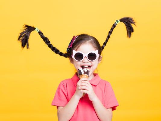 smiling little girl eating ice cream