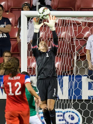 Hope Solo makes a save during her U.S. record 72nd career shutout.