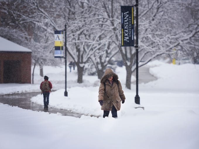 Augustana sophomore Doanh Do walks to class in the