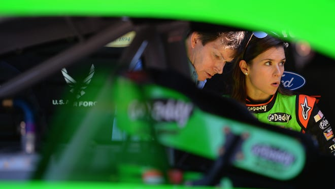 Danica Patrick, driver of the #10 GoDaddy Chevrolet, stands in the garage area during practice for the NASCAR Sprint Cup Series Daytona 500 at Daytona International Speedway on February 15, 2014 in Daytona Beach, Florida.
