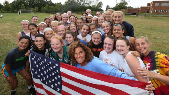 Suffern field hockey coach Gaby Somma, second from right in front, and junior varsity coach Jocelyn Rondina, right, with their teams at Suffern Middle School Sept. 22, 2015. The teams will be running in the Tunnel to Towers 5k run in New York City on Sept. 27.