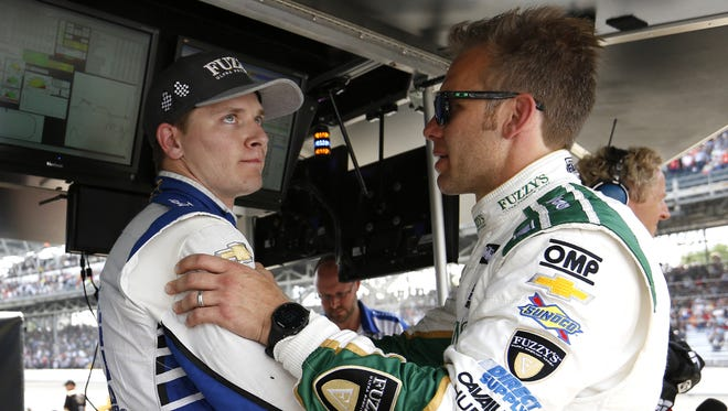 Josef Newgarden shows his disappointment after finishing third while talking to team owner Ed Carpenter following the 100th running of the Indianapolis 500 May 29, 2016.