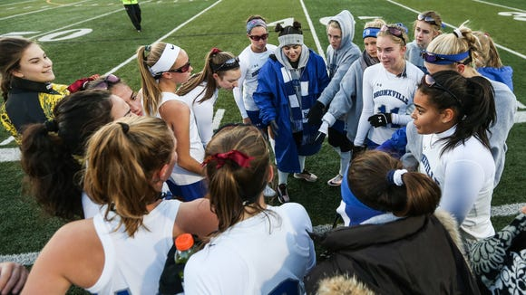 Bronxville's players come together during a timeout
