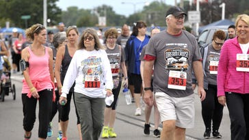 Runners cruise with shoes down Woodward
