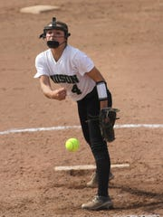 Madison's Sloan Kiser pitches while playing in the
