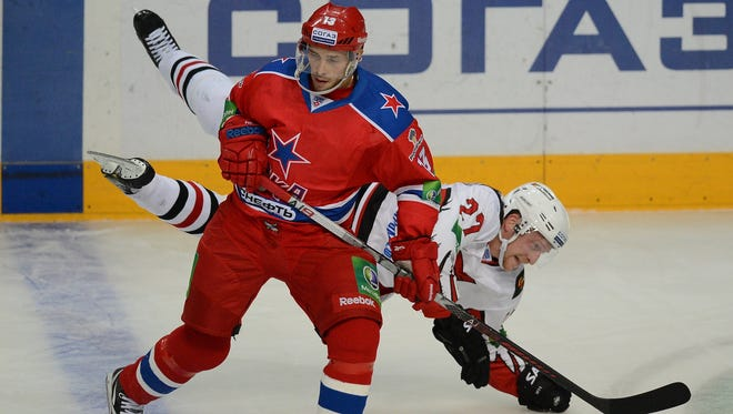 SKA Moscow star Pavel Datsyuk, left, fights for a puck with Avangard Omsk in Moscow on Sept. 24, 2012.