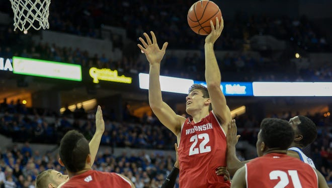 Ethan Happ attempts a shot against the Creighton in November. Happ and the Badgers are in the same tournament with Creighton next season.