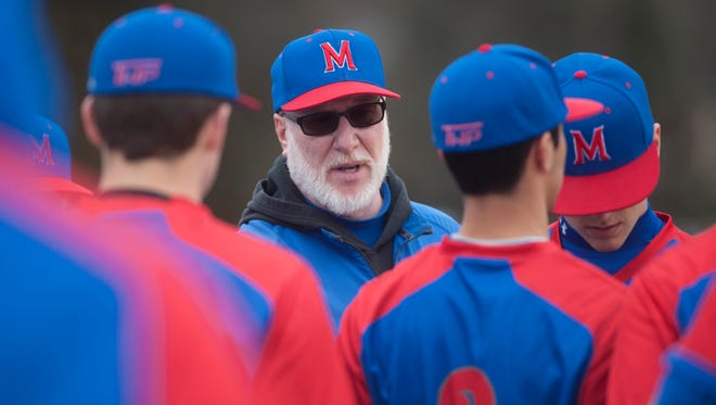 Bob Kelly speaks with the Washington Township baseball team earlier this season. Kelly coached the first few weeks of the year under the interim tag, but he was officially named the head coach on Monday.
