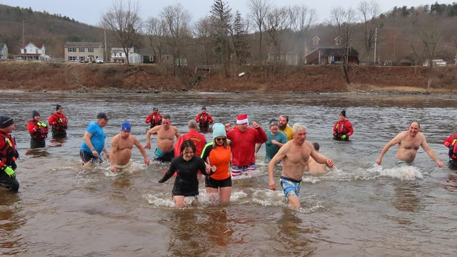 Seven members of the Port Jervis Fire Department's Water Operations Team (Mike Aumick, Keith Brown, Tyler Kowinsky, Bryce Sotelo, Dana Presto, Justin Brewster, and Petey Fuller) were stationed around the designated area of the Delaware River where 61 participants went in for Port's first Polar Plunge.