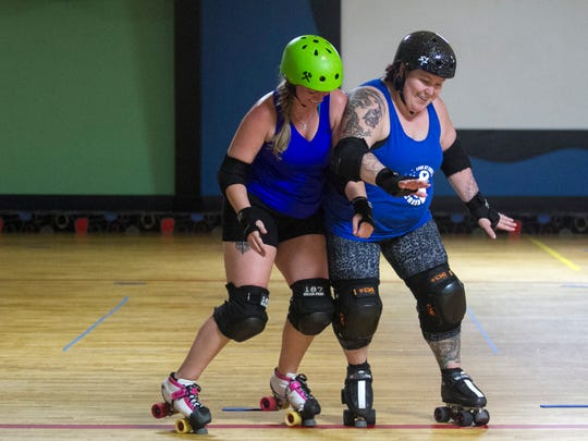 AlishaMorgan, aka BubbleVicious,  and Kelsey Johns , aka Bellicose Blondie, work on defensive maneuvers during practice for the Fort Myers Derby Girls.