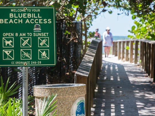 Signage at the public entrance to the Bluebill Beach Access point in Naples, which is located immediately next to a private stretch of beachfront for residents of the Moraya Bay Beach Tower, as seen on Thursday, Oct. 26, 2017.