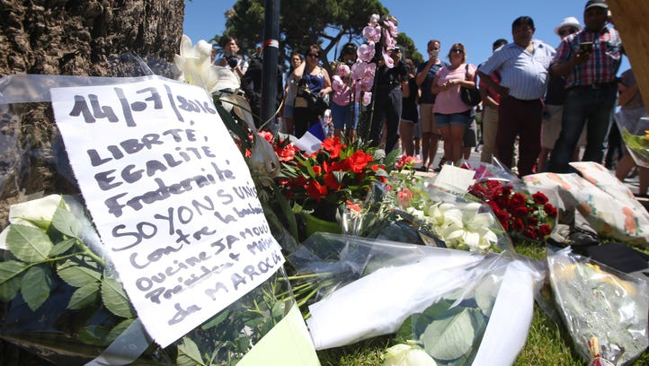 Floral tributes are laid out near the site of the truck attack in the French resort city of Nice, southern France, Friday, July 15, 2016.