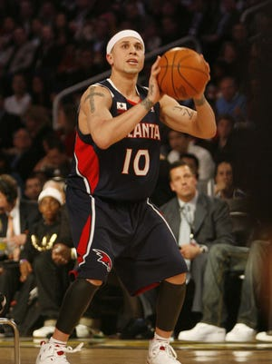 Mike Bibby of the Atlanta Hawks participates in the Foot Locker Three-point Shootout as part of the NBA All-Star weekend at US Airways Arena in Phoenix on Saturday, February 14, 2009.