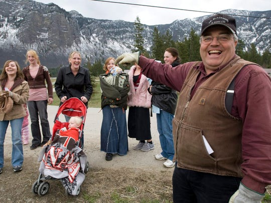 In this April 21, 2008, file photo, Winston Blackmore, the religious leader of the controversial polygamous community of Bountiful located near Creston, British Columbia, Canada, shares a laugh with six of his daughters and some of his grandchildren. Blackmore was convicted Monday, July 24, 2017, of practicing polygamy after a decades-long legal fight.