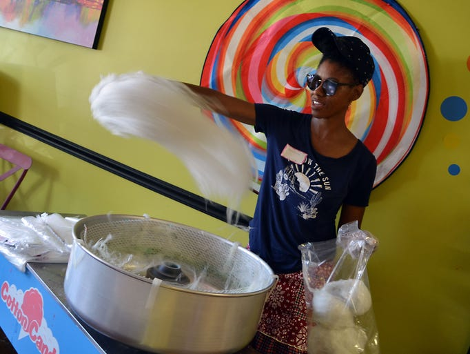A cloud of cotton candy whirls through the air as Cotton