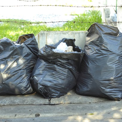Row of garbage bags.