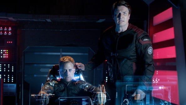 Alan Tudyk (left) and Nathan Fillion in a scene from