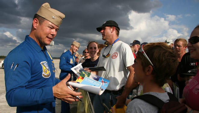 Capt. Greg McWherter, commanding officer of the the Blue Angels Navy flight demonstration squadron in 2010, signs autographs after performing at the Naval Air Station Jacksonville Air Show.