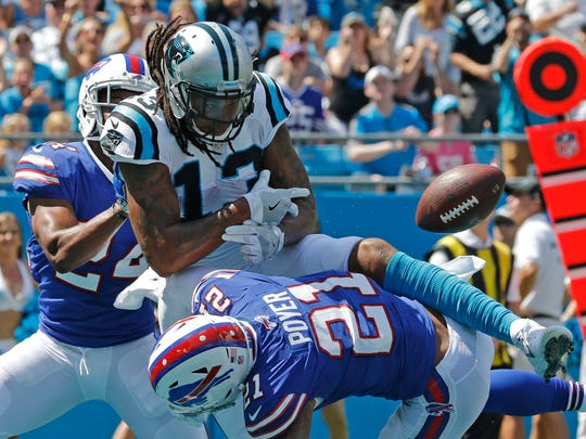 Carolina Panthers' Kelvin Benjamin (13) misses a catch as Buffalo Bills' Leonard Johnson (24) and Jordan Poyer (21) defend in the first half of an NFL football game in Charlotte, N.C., Sunday, Sept. 17, 2017. (AP Photo/Bob Leverone)
