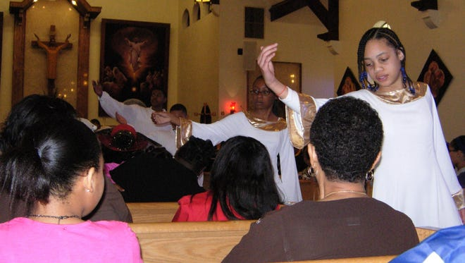 In this Daily World file photo members of the Holy Ghost Youth Group perform at the annual Martin Luther King Jr. Parade and Program held at Holy Ghost Catholic Church.