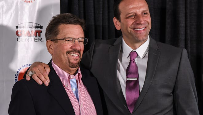 Doug Yingst, former general manager of the Hershey Bears, left, poses for a picture with Bryan Helmer after the Hershey Bears announced the former player and assistant coach as the new vice president of hockey operations on Thursday.