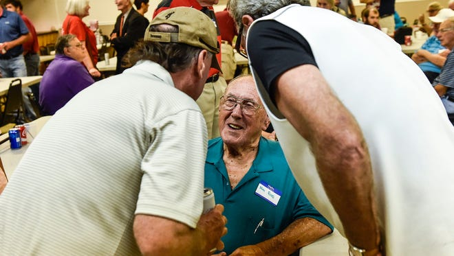 Former Marion Catholic High School football coach Max Ross (center) speaks with former students at the Knights of Columbus building before making an appearance at the Harding Football game on Friday Night.