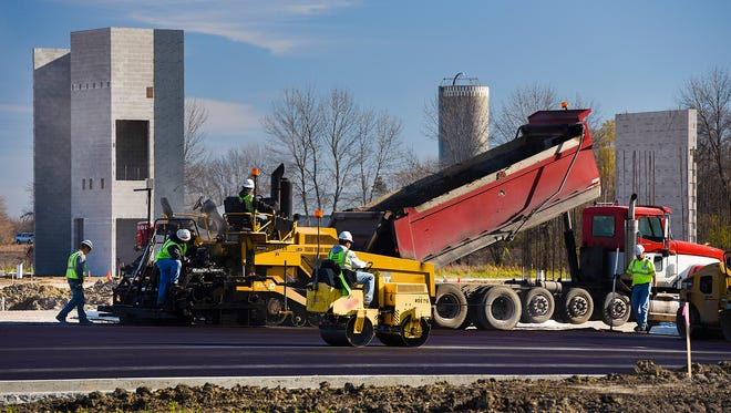A paving crew from Knife River Corp., Sauk Rapids, put down the first layer of asphalt for the parking of the new Sartell Community Center Wednesday, Nov. 9, in Sartell. The lot will have about 250 stalls when complete.