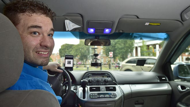 Glen May, Chambersburg, photographed August 9, is a Franklin County Uber driver.