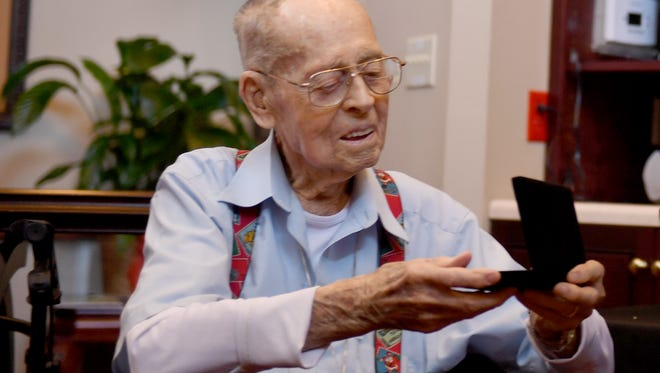 Jackson City Mayor Jerry Gist presented 103-year-old Richard Drewry with the key to the city, Tuesday morning, June 13 at Elmcroft of Jackson.
